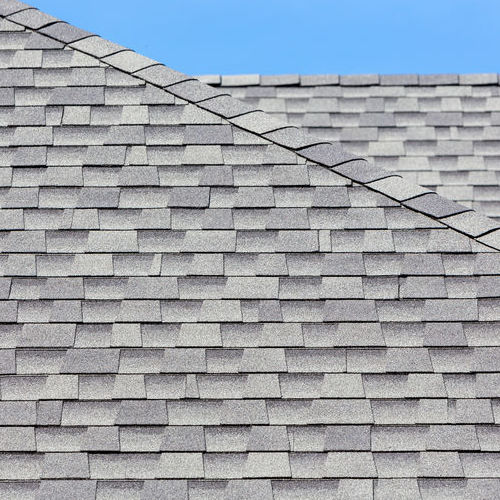 Close up of new rubber roof tiles with blue sky background.