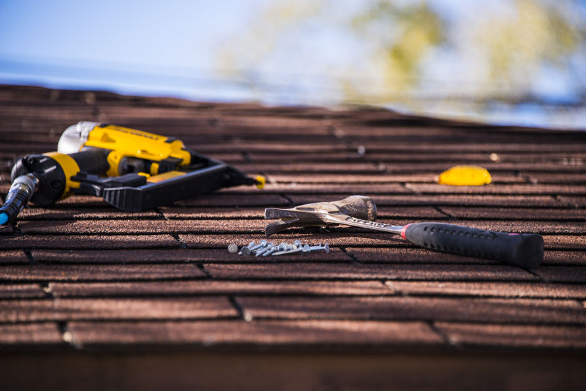 roof repairing with tools on roof