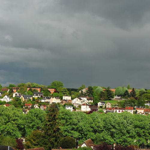 grey storm clouds over a residential neighborhood